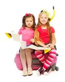 Two little girls ready for vacation royalty free stock image