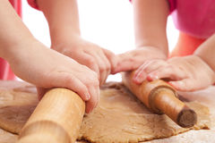 Two little girls with rolling pins baking Royalty Free Stock Photography
