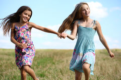 Two little girls running in summer field Royalty Free Stock Photography