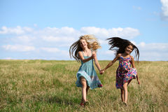 Two Girls Running The Field Royalty Free Stock