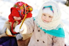 Two little girls in the Russian shawls against the backdrop of s. Now Stock Images
