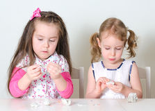 Two little girls sculpting Royalty Free Stock Image