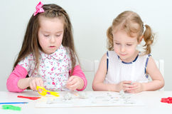 Two little girls sculpting Royalty Free Stock Photo