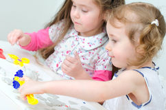 Two little girls sculpting Royalty Free Stock Photography
