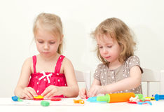 Two little girls sculpting Stock Photo