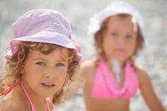 Two little girls on a sea coast. Royalty Free Stock Photo