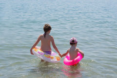 Two little girls on the sea Stock Photography