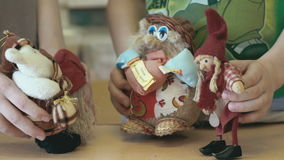 Two little girls show the talking scene with toys stock video