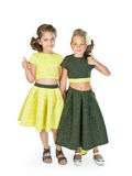 Two little girls in similar fancy dresses Royalty Free Stock Photography