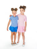 Two little girls in similar fancy dresses Royalty Free Stock Images
