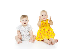 Two little girls sit and play Stock Image