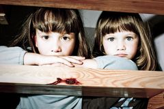 Two little girls sitting on stairs Stock Images
