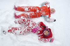 Two little girls in the snow Royalty Free Stock Image