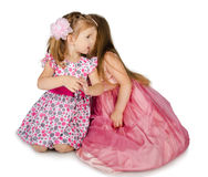 Two little girls speaking with each other Royalty Free Stock Photo