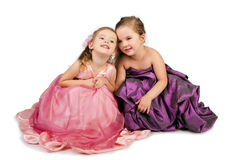 Two little girls speaking with each other Stock Photography