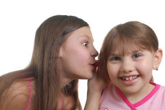 Two little girls speaking about something. (isolated over white background Stock Photography