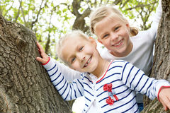 Two little girls in the spring park Stock Photography