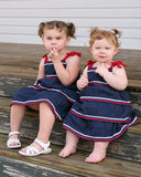Two little girls in sun dresses Royalty Free Stock Photo