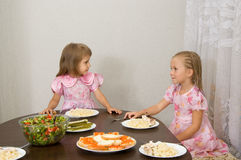 Two little girls at the table Royalty Free Stock Image
