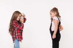 Two little girls taking a picture of each other Royalty Free Stock Photos