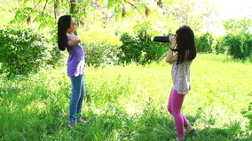 Two little girls taking pictures stock video footage