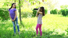 Two little girls taking pictures stock footage