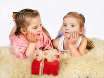 Two little girls talking and gift box Royalty Free Stock Photo
