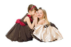 Two little girls talking. Isolated Royalty Free Stock Image