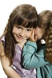 Two little girls telling secrets Royalty Free Stock Photos