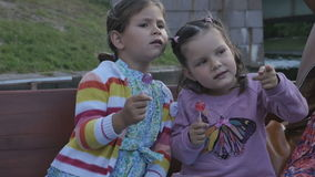 Two little girls with their parents in a tourist boat along the rivers stock video footage