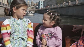 Two little girls with their parents in a tourist boat along the rivers stock video