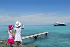 Two little girls tourist in turquoise beach Stock Images