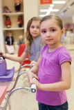 Two little girls in a toy store with dolls Stock Photo