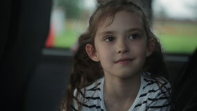 Two little girls travel by bus, look out the windows and admire nature stock footage