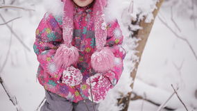 Two little girls walk on a snow-covered forest stock video footage