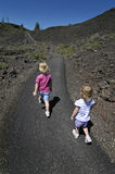 Two Little Girls Walking. On pathway trail Royalty Free Stock Image