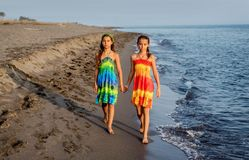 Two little girls walking together on the beach Royalty Free Stock Photography