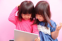 Two little girls watching tablet Stock Photo