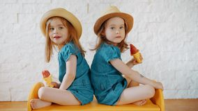 Girls waving their hands and waiting for vacation. Two little girls waving their hands and waiting for summer vacation stock video footage