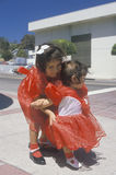 Two little girls wearing red dresses, Ventura, CA Royalty Free Stock Photos