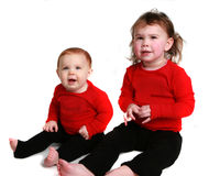 Two little girls on a white background stock images