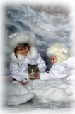 Two little girls in white coats  and white fur hats Stock Photography