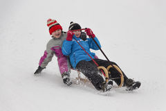 Two little girls in winter activity Stock Image