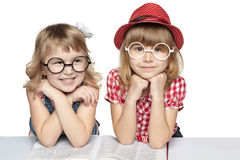 Two Little Girls With A Book Stock Photos