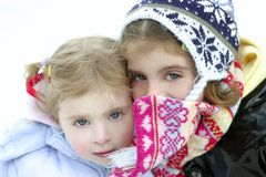 Two little girls with wooden winter hat Stock Photography