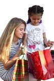 Two little girlswith shopping bags. Two little girls with shopping bags. Isolated over white background Royalty Free Stock Photos
