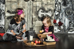 Two little halloween witches Stock Images