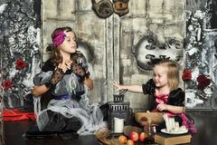 Two little halloween witches Stock Image