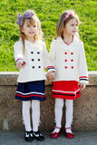 Two little happy girls in port Stock Image