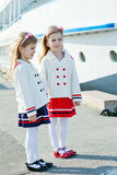 Two little happy girls in port Stock Photo